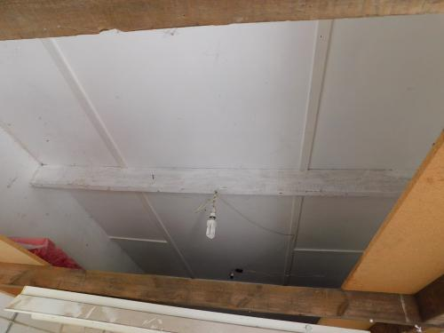This garage ceiling in Bembridge looks in good order, but was identified as Amosite (Brown Asbestos) which is dangerous. Removal was very expensive
