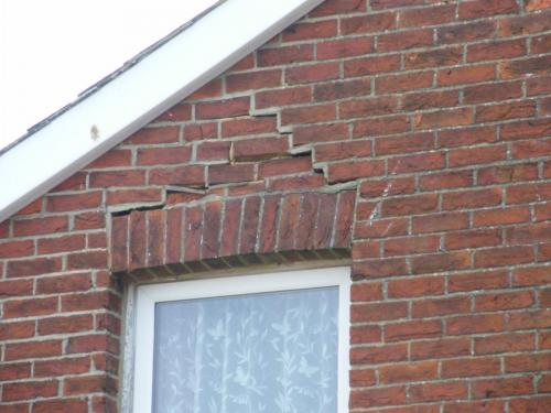 Failed timber lintel on inner leaf of wall causing arch to fail at flat in Shanklin